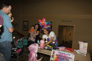 Attendees get balloon animals made by alpacaglobo balloons