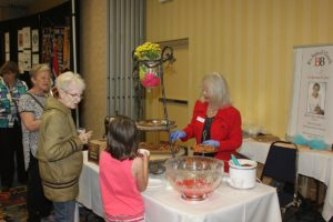 Chocolatier hands out chocolate samples to attendees